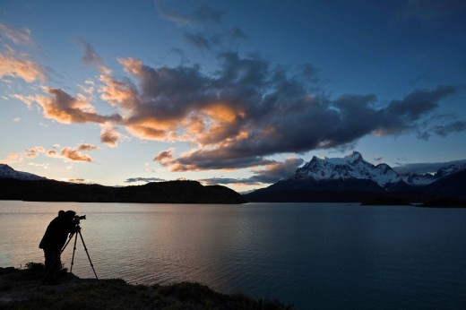 Photographer at the Torres del Paine mountains, Lago Pehoe, National Park Torres del Paine, Patagonia, Chile, South America : Stock Photo