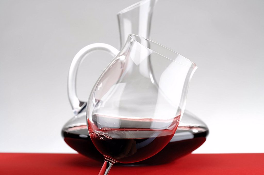 Decanter and wine glass filled with red wine : Stock Photo
