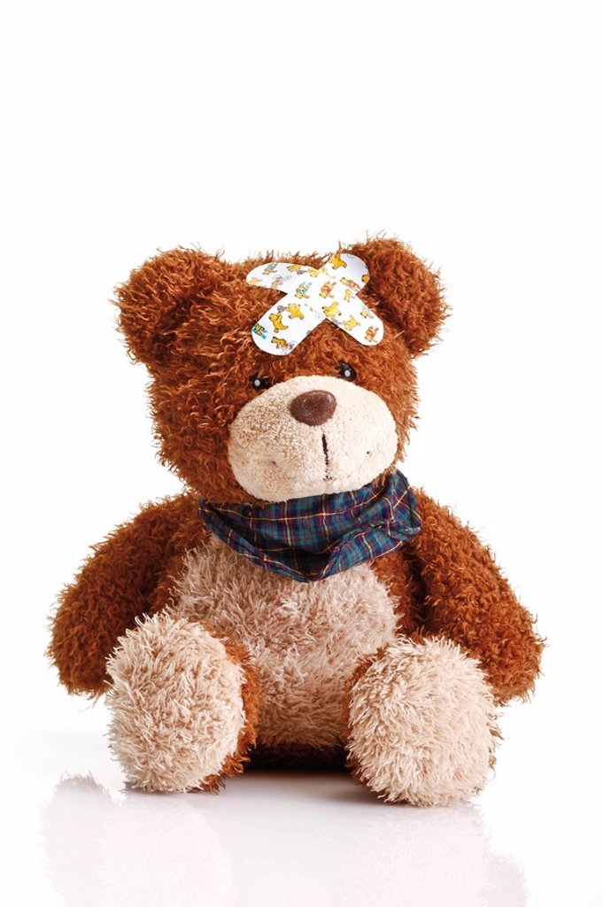 Stock Photo: 1848R-308956 Teddy bear with band-aids on its head
