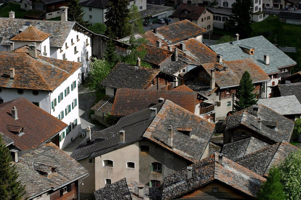 View over the roofs of old Splügen, distinguished with the Wakker price of the Swiss homeland protection organization Schweizer Heimatschutz, Splügen, Graubünden, Switzerland : Stock Photo