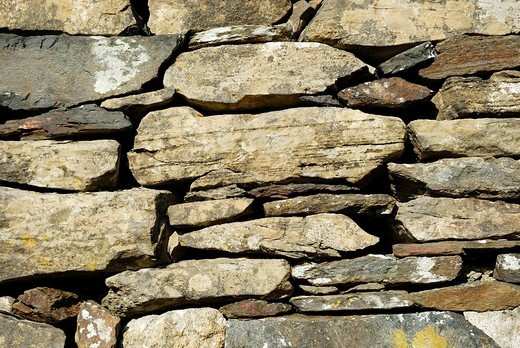 Wall of the historic early christian Saint Columcille abbey, constructed from piled up stones, Co Donegal Ireland : Stock Photo