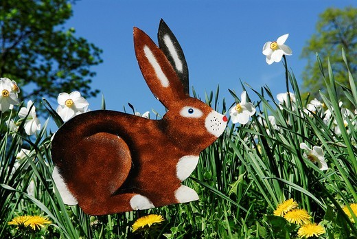 Easter bunny, decoration on a flower meadow : Stock Photo