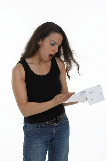 Stock Photo: 1848R-311032 Woman checking a bill, angry