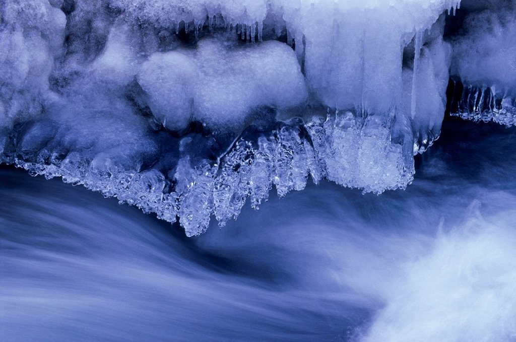 Stock Photo: 1848R-311077 Ice formations along a mountain stream in winter
