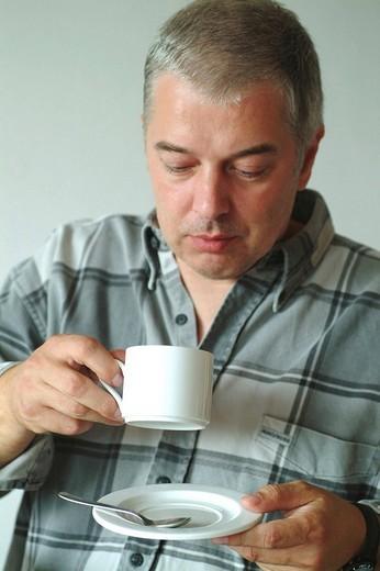 Man drinking coffee : Stock Photo