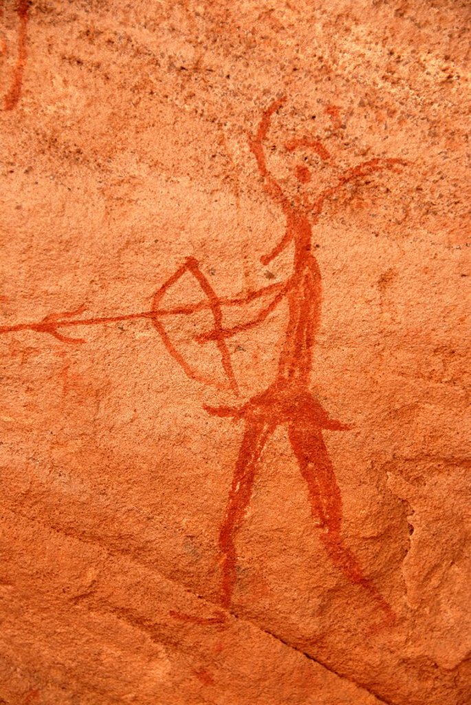 Stock Photo: 1848R-311636 Neolithic rock drawing of a human with bow and arrow and an animals head Acacus Libya