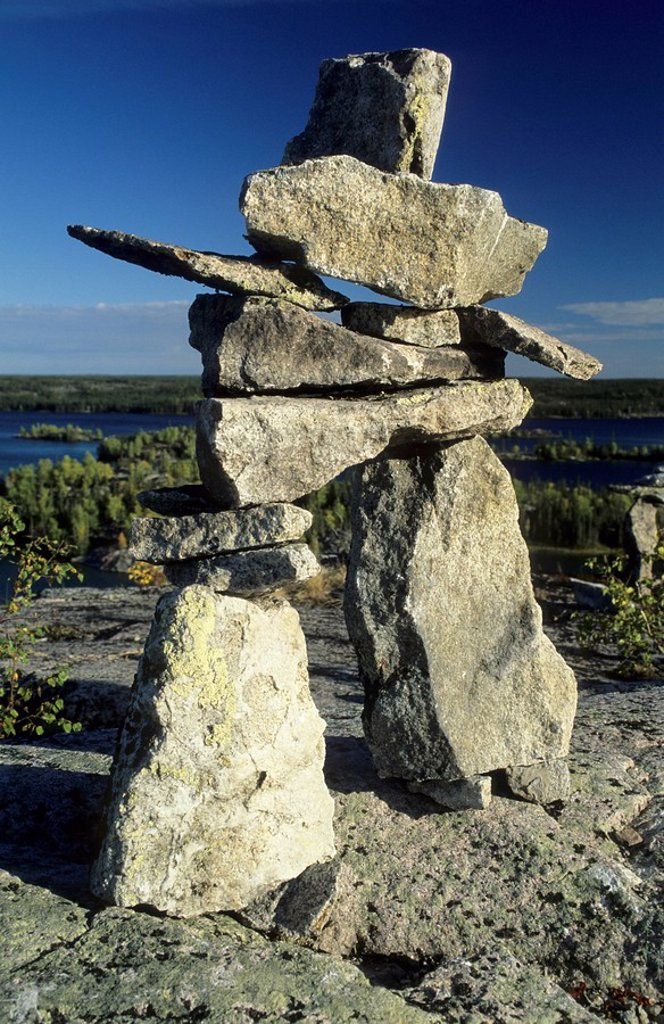 Cairn or stone man or inukshuk at the Hidden Lakes, Ingraham Trail, Northwest Territories, Canada : Stock Photo