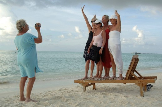 Elderly women filming each other with a video camera on the beach, Diffushi Island, Holiday Island, Southern Ari Atoll, Maldives, Indian Ocean : Stock Photo