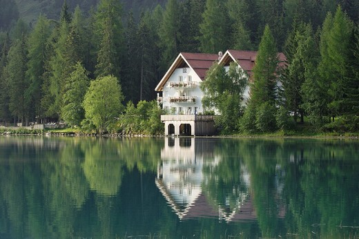 Stock Photo: 1848R-313275 A hotel mirrors in the Antholzer Lake, South Tyrol, Italy