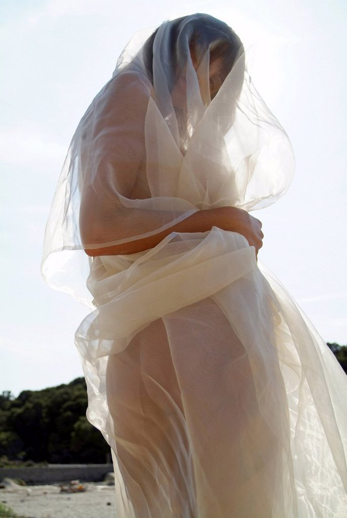 Stock Photo: 1848R-315979 Naked young woman wrapped in transparent cloth on the beach in Mallorca, Spain, Europe