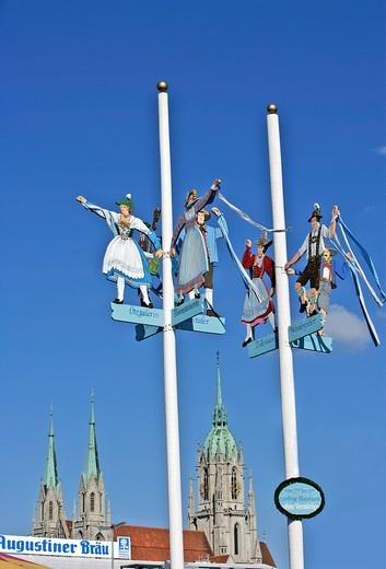 Bavarian folklore figures, national costumes, on flagpoles, Oktoberfest, Munich, Bavaria, Germany : Stock Photo