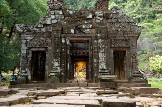 Ancient Shiva sanctuary with Buddha statue Wat Phu Champasak Laos : Stock Photo
