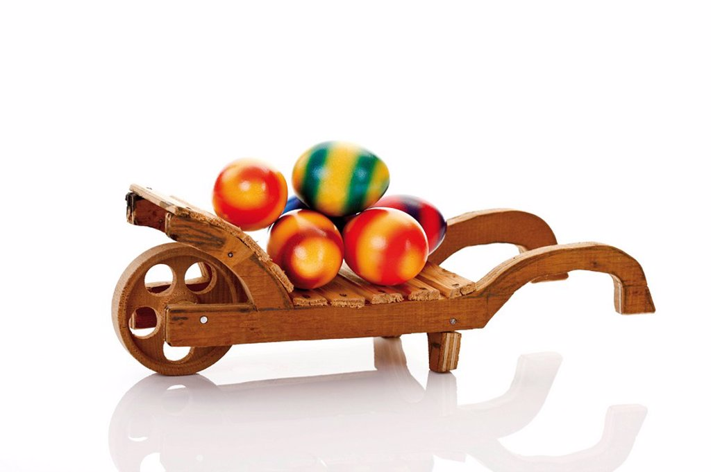 Wheelbarrow with colored easter eggs : Stock Photo