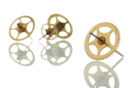 Stock Photo: 1848R-316545 Gear with two gears in the back, symbolic picture for team and outsider