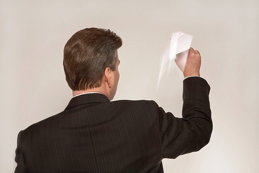 Stock Photo: 1848R-317101 Businessman throwing a paper airplane