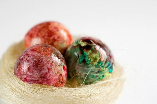 Three painted, coloured Easter eggs in a nest : Stock Photo