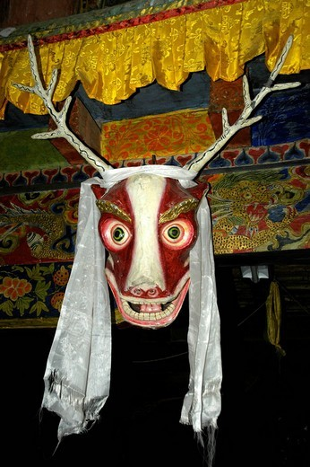 Deer-like mask in the old monastery gompa of Dzong Mustang Annapurna Region Nepal : Stock Photo