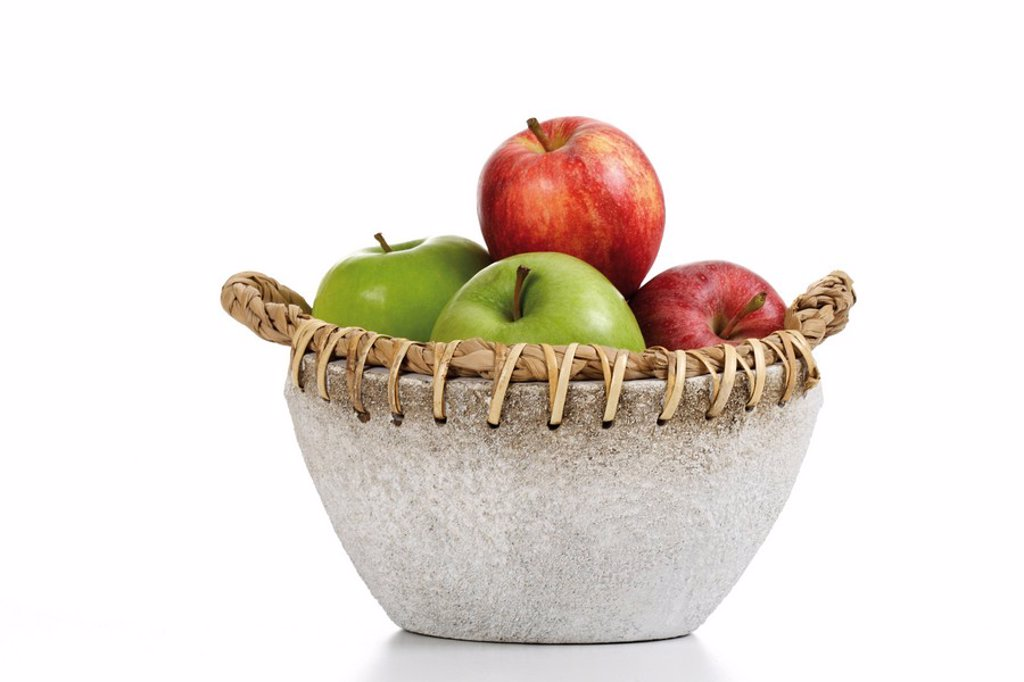Apples in a stone bowl : Stock Photo