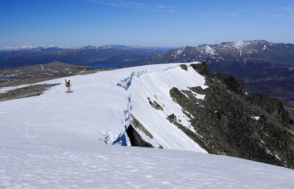 Hiker, snow cornices, vast snowy landscape, Jotunheinem National Park, Norway, Scandinavia : Stock Photo
