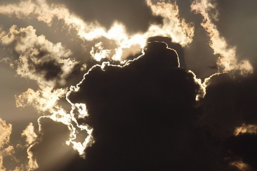 Stock Photo: 1848R-320474 Sun behind dark storm clouds