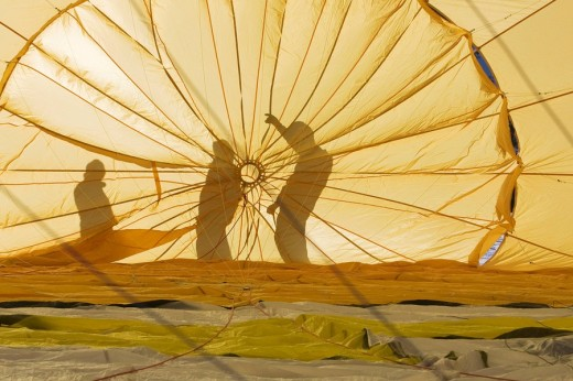 Hot air balloon from the inside with sihouettes, Filzmoos, Salzburg, Austria, Europe : Stock Photo