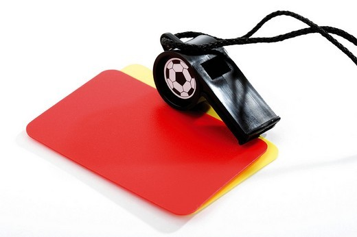 Red and yellow cards with a referee´s pipe : Stock Photo