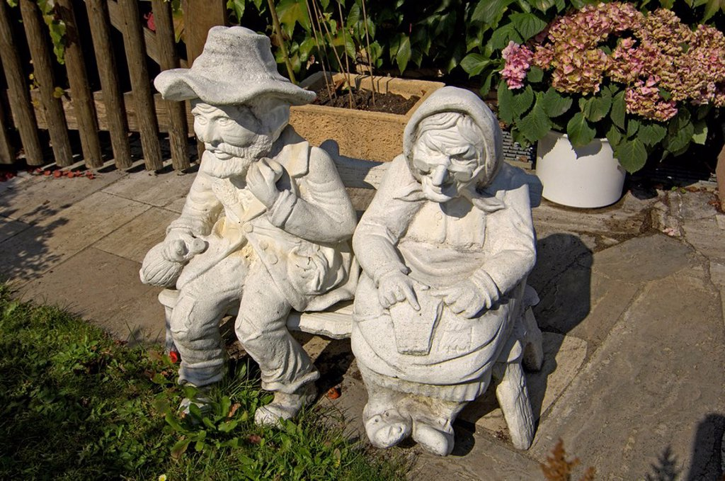 Figure figurine of old couple in a garden in Egmanting Upper Bavaria Germany : Stock Photo