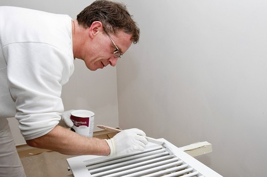 Painter lacquering lamella door : Stock Photo