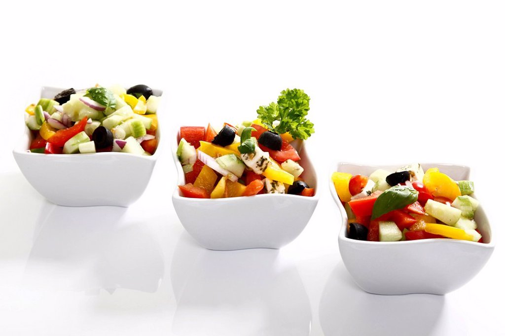 Greek salad with onions, tomatoes, capsicum, feta and olives in small bowls : Stock Photo