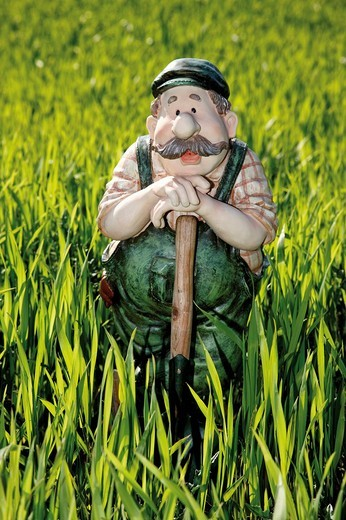 Gardener, farmer figurine in a wheat field : Stock Photo