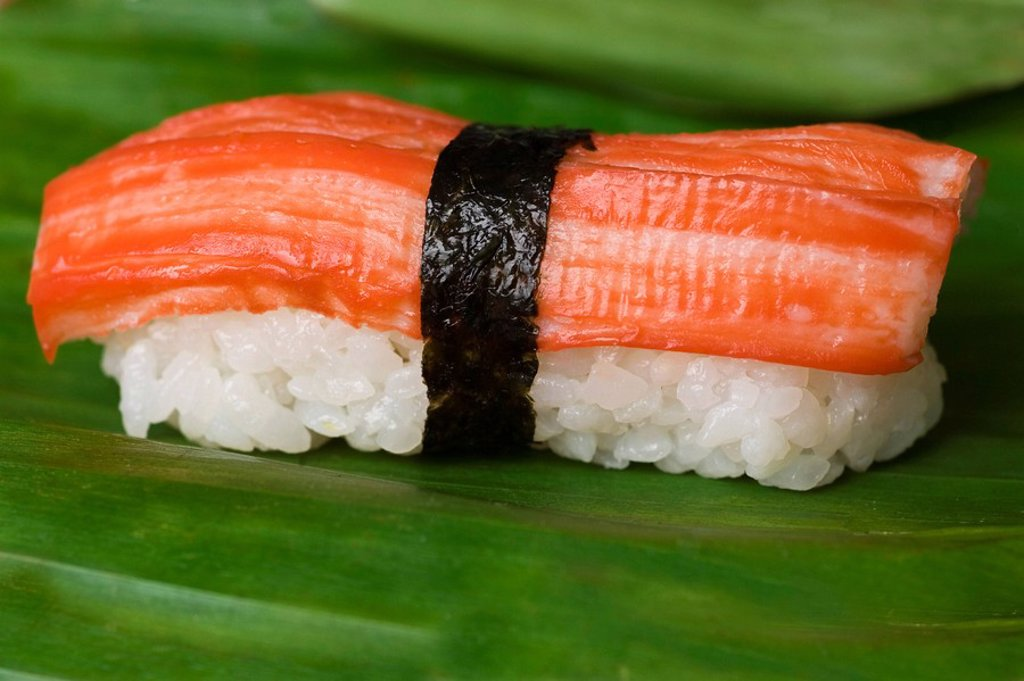 Stock Photo: 1848R-324730 Sushi with surimi, artificial crab meat, on a banana leaf
