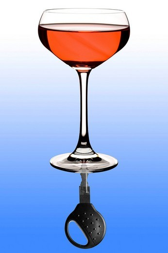 Wine glass, car key, symbolic of drink_driving : Stock Photo