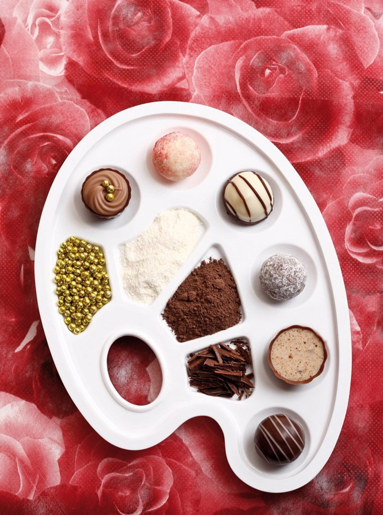 Chocolates on a colour palette : Stock Photo
