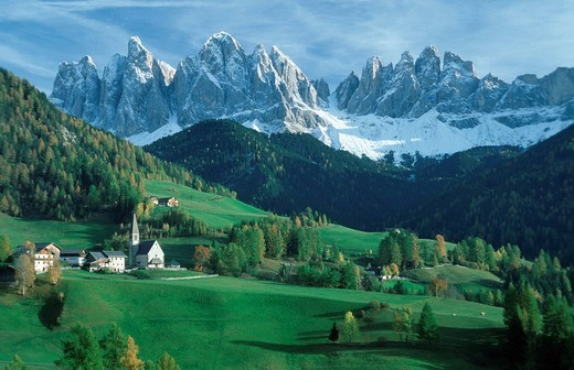 Mountain village in front of the Geisler group, Dolomites, South Tyrol, Italy : Stock Photo