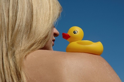 Woman with rubber duck : Stock Photo