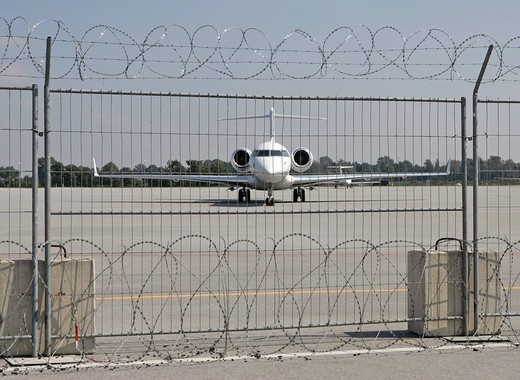 Stock Photo: 1848R-326558 Privat jet behind a security fence at general aviation area at Munich Airport Bavaria Germany