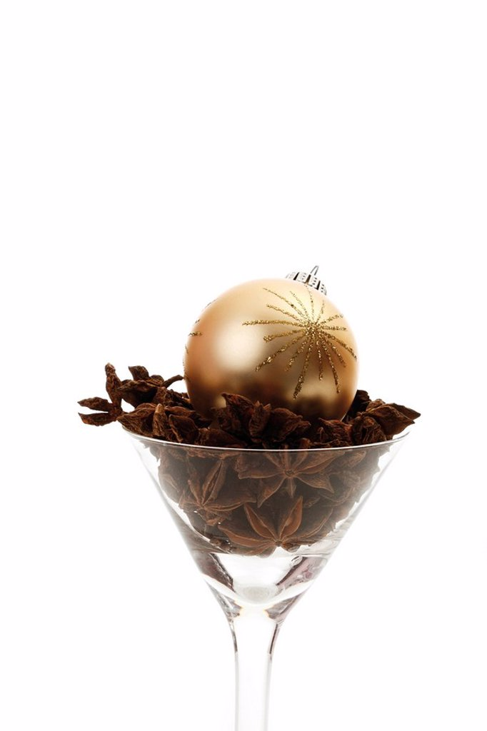 Christmas tree ball in a glass with star anise : Stock Photo