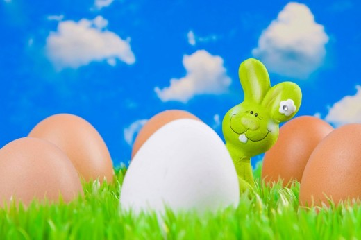 Stock Photo: 1848R-327494 Easter bunny hiding behind eggs
