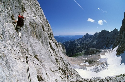 Woman climbing the via ferrata to Zugspitze Hoellental Germany : Stock Photo