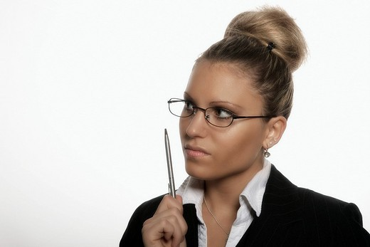 Businesswoman with a pen in her hand : Stock Photo