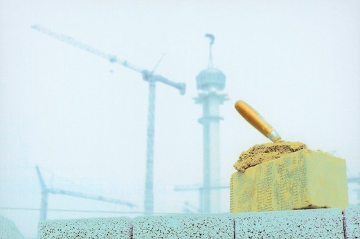 Stock Photo: 1848R-327876 Stone and trowel at building site, Hanover, Lower Saxony, Germany