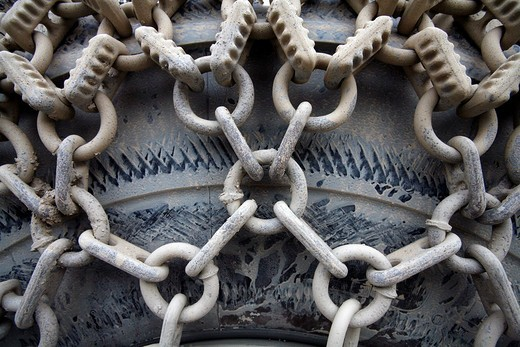 Tire chain from carbide on the wheel of a wheel loader : Stock Photo