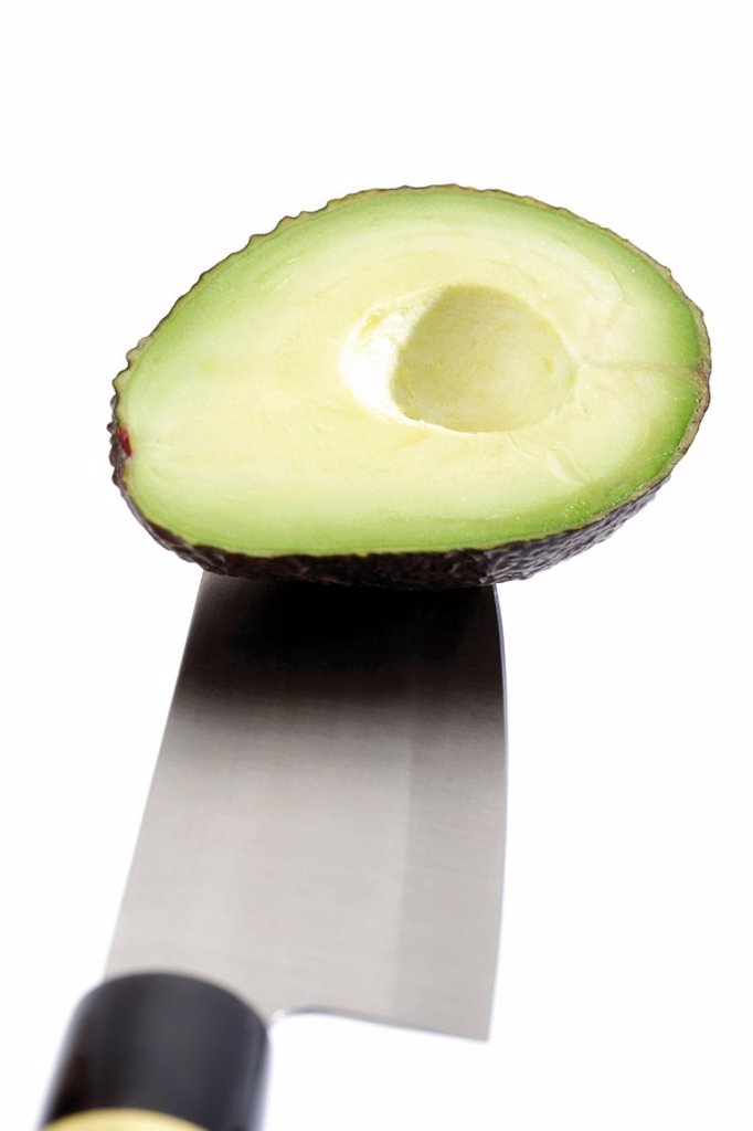 Stock Photo: 1848R-328495 Avocado half on a knife