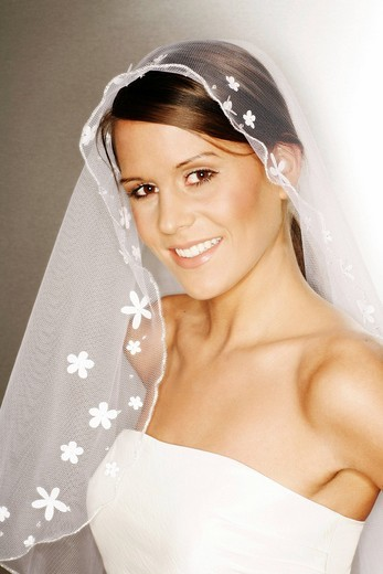 Young woman, 24 years, in bridal outfit : Stock Photo