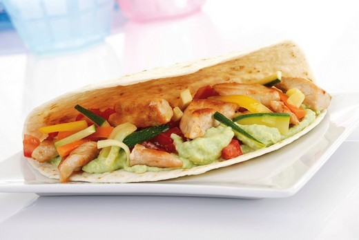 Stock Photo: 1848R-328811 Tortilla with vegetable, chicken and guacamole