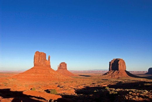 Redrock buttes The Mittens and Merrick Butte, Monument Valley Navajo Tribal Park, Utah, USA : Stock Photo