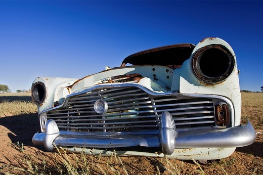 Old car wreck lying in the Veld or plain, Namibia, Africa : Stock Photo