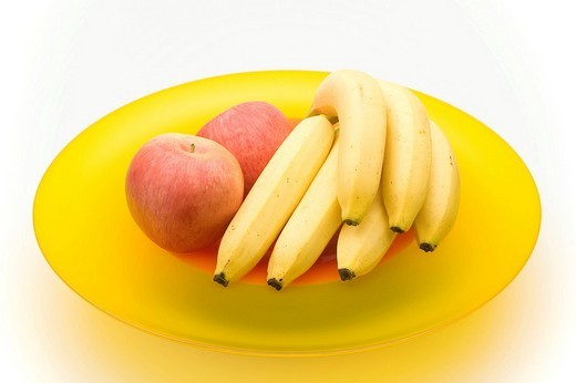 Apples and bananas in a glass bowl : Stock Photo