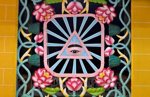 The eye, sacred symbol of the Cao Dai sect, Tay Ninh, Vietnam, Asia : Stock Photo