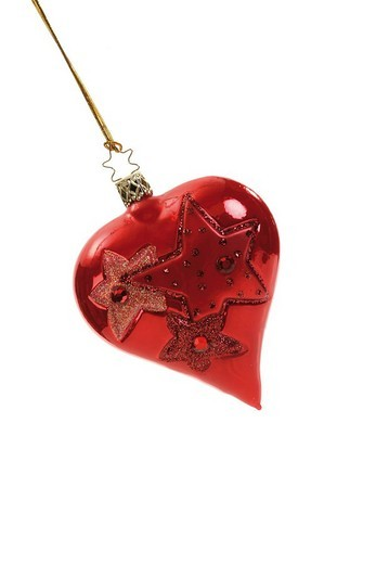 Red heart-shaped Christmas ornament on gold thread : Stock Photo